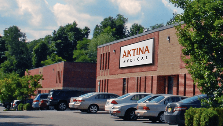 Front of Aktina Medical building with cards