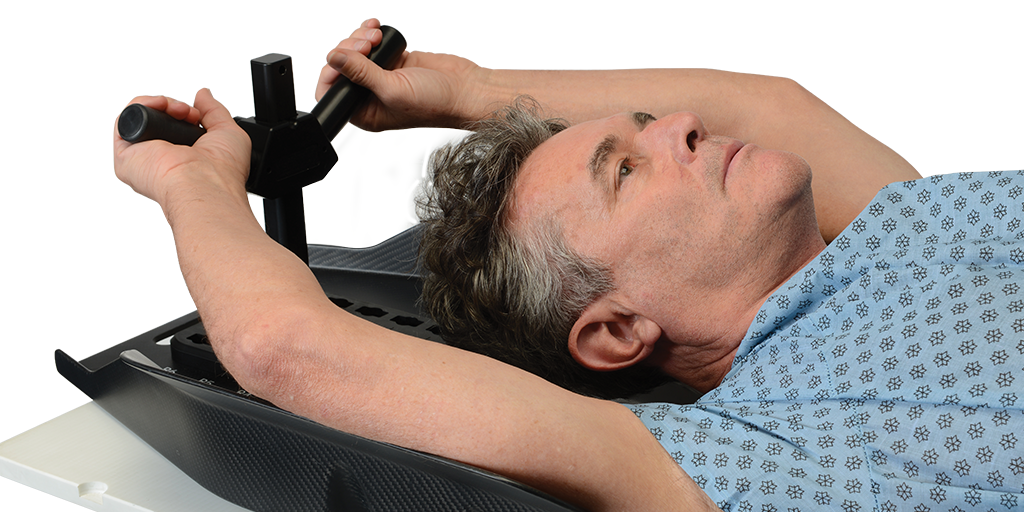 Patient lying down using Arm Cradle 4 with Y handle hand position